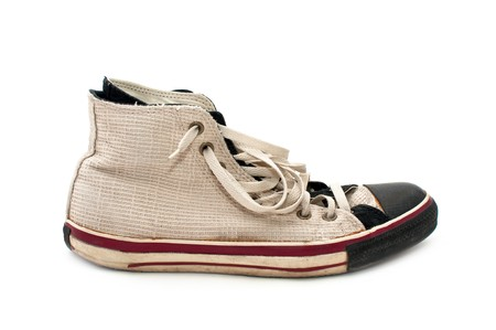 lacing sneakers: old, dirty sneakers over white background