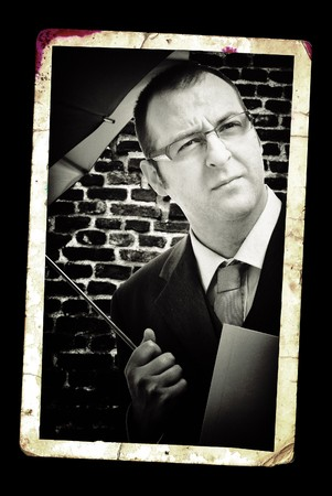 detective agency: Businessman with umbrella, classic black and white portrait.