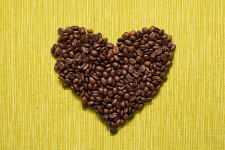caffiene: Beautiful brown coffee beans, heart shaped