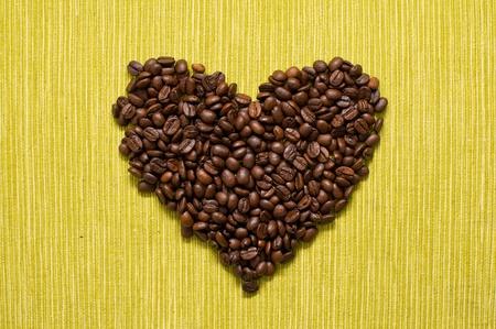 Beautiful brown coffee beans, heart shaped