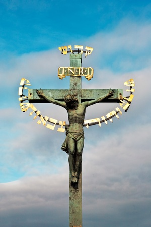 crucifiction: Famous statue on King Karls Bridge in Prague, the Czech capital.