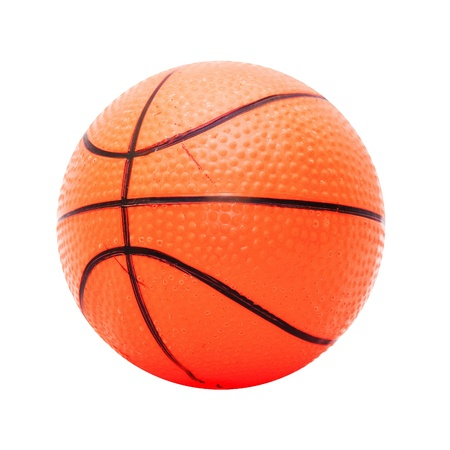 Small plastic basketball, image is taken over white background. photo
