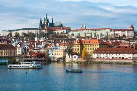 vitus: View of Prague city skyline viewed over Vlatava river with Prague Castle and Saint Vitus Cathedral Stock Photo