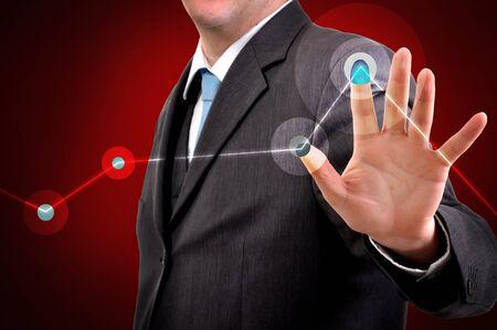 press agent: Businessman pressing a touchscreen button, copyspace Stock Photo