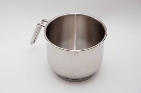 A metal cooking pot with stains photo