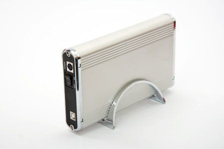 EXternal metallic hard drive case over a white background photo