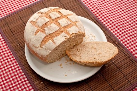 unsliced: Buckwheat bread loaf on a kitchen table