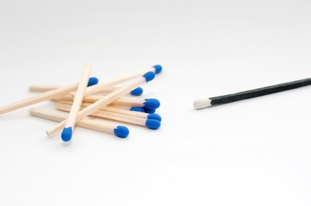 singular: Macro of matches over a gray background.  Stock Photo