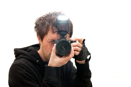 flash: photographer shooting with the dslr camera and flash, isolated on white.