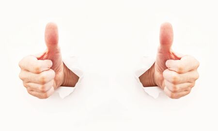 Thumb up, over a gray background photo