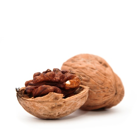 nut shell: Close up image of walnut over a white background.
