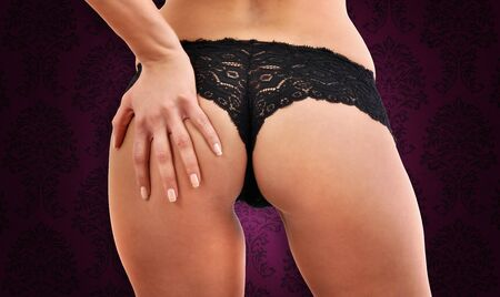 Close-up of female bottom with black panties Stock Photo - 9049104