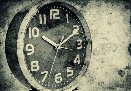 Vintage clock over a grunge paper background photo