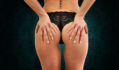 Close-up of female bottom with black panties Stock Photo - 9256896