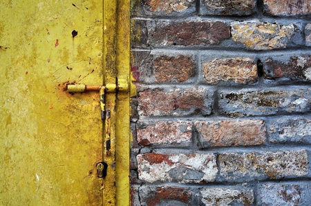 Old grunge metal doors and a brickwall detail. photo