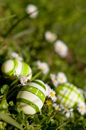 easter decorations: Manually decorated and painted easter eggs in spring glass with flowers Stock Photo