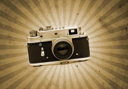 Old analog camera blended on a grunge paper textured image photo