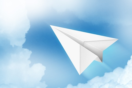 Paper plane flying through the air photo