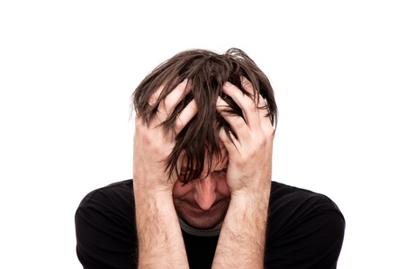 Young man looking anxious and worried, having a headache Stock Photo - 9619657