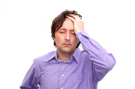 Young businessman looking anxious and worried, having a headache Stock Photo