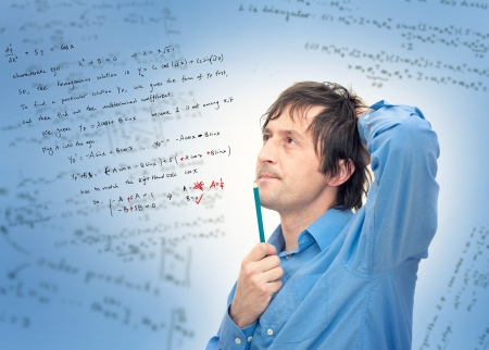 mathematic: Portrait of a young scientist solving a complex math formula.