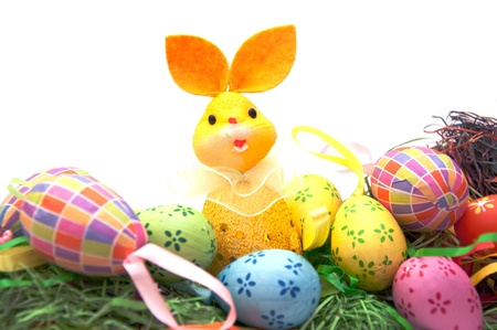 manually: A rabbit doll  and manually decorated and painted easter eggs. Painted eggs are the part of peoples tradition in christian culture.