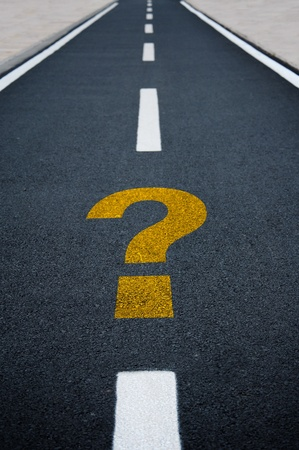 ahead: A straight tamac bicycle road with question mark Stock Photo