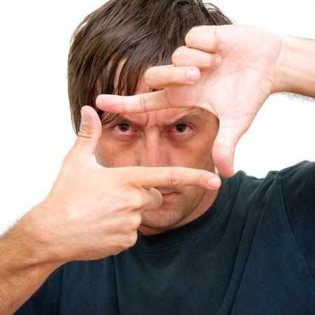 frame  box: A man looking through his hands in a frame box