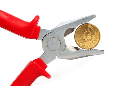 miserly: Euro coin squeezed in a clamp. Stock Photo