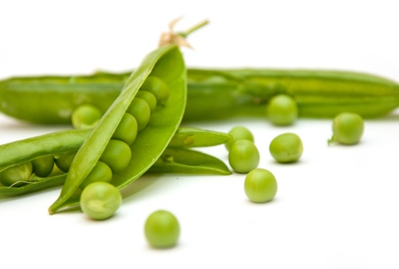 Green peas pods over a white background photo