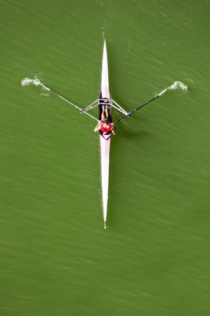 image of a young man rowing in kayak down the river photo