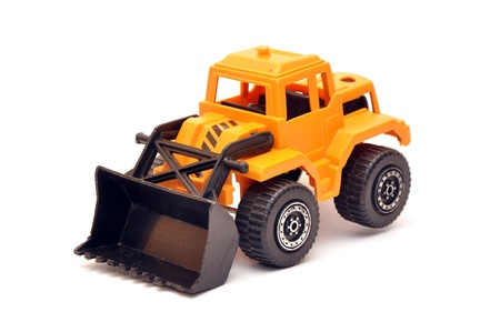 bulldozers: Yellow toy digger over a white background with soft shadow
