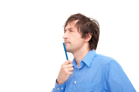 man confused: Portrait of a young businessman holding a pencil and thinking.