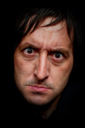 Very angry caucasian man, close-up low key portrait Stock Photo - 10024268