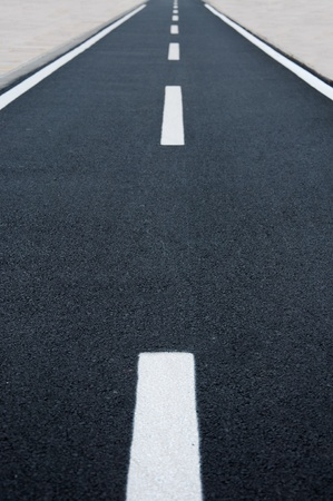 A straight tamac bicycle road Stock Photo - 10150146