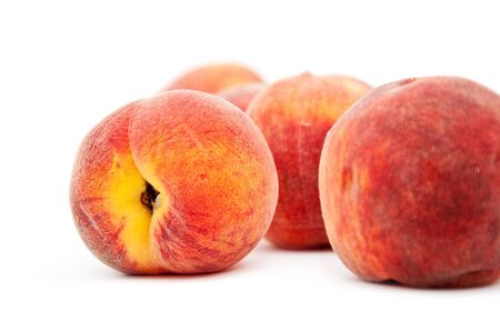 Few sweet peaches against a white background. Stock Photo - 10252304