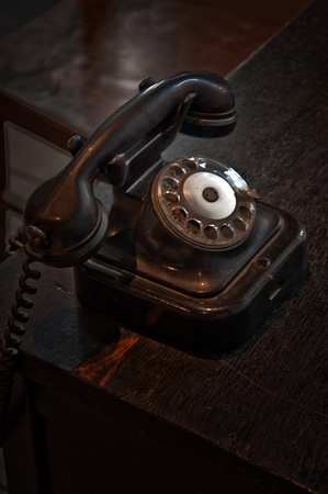 Vintage telephone on an old wooden table. photo