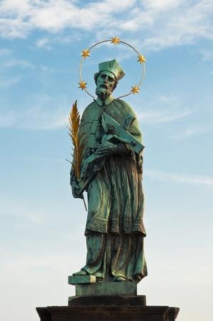 st charles: St. John of Nepomuk (Ian Nepomuk) on Charles bridge, Prague, Czech republic Stock Photo