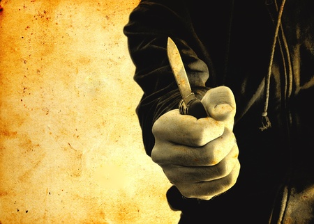 ladrones: Agacharse ladr�n con un cuchillo peque�o