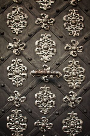 Metal ornament on dark meatl background Stock Photo - 11126983