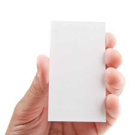 Extended hand holding an empty business card over white background photo