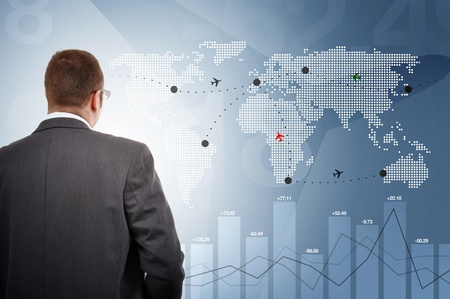 trad: Manager controlling flights of aeroplanes around the world Stock Photo