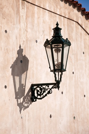 Wrought-iron lantern with its shadow on the yellow wall, Prague, Czech Republic Stock Photo - 11310934