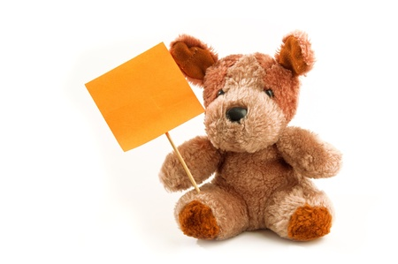 stuffed toy: Cute little bear toy holding a note on a wooden stick over a white background