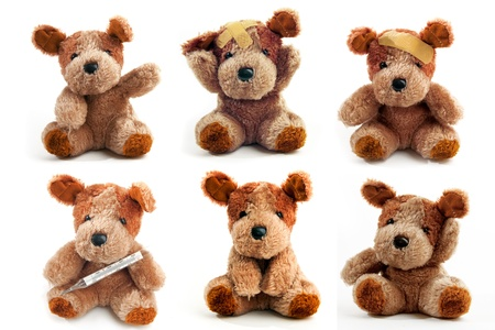 Cute little teddy bear over a white background, illnes concept. photo