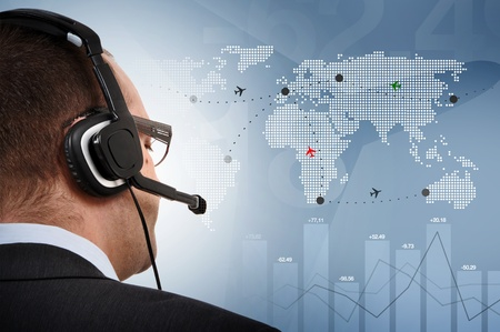 security room: Manager controlling flights of aeroplanes around the world Stock Photo