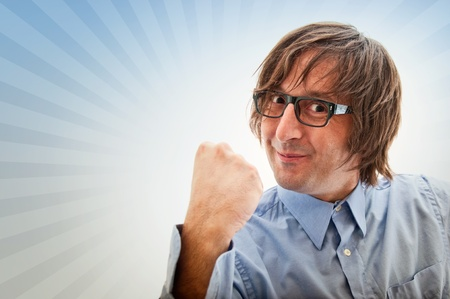 Funny looking businessman showing his fist Stock Photo - 11311862
