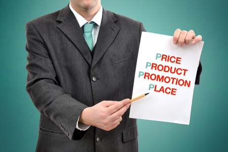 Businessman holding a paper with printed marketing terminology. Stock Photo - 11311968