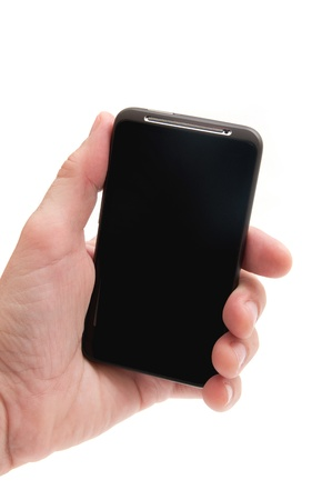 MAle hand holding a smart phone mobile communicator over a white background. photo