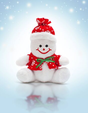 Smiling snowman toy dressed in scarf and cap photo